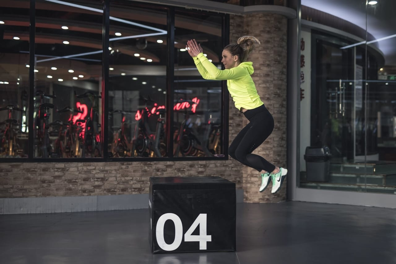 woman-exercising-with-box
